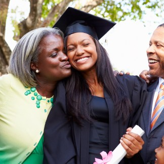 Family surrounding a proud graduate