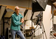 Philip Heying, a photography professor at JCCC, poses in the studio area of the photo lab
