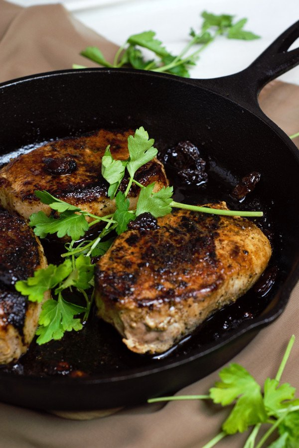 Fully Glazed Pork Chops served straight from the cast iron skillet.