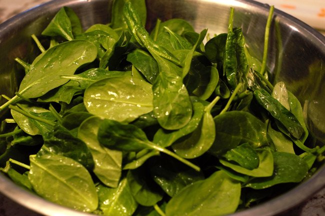 Baby Spinach leaves washed and ready in a mixing bowl