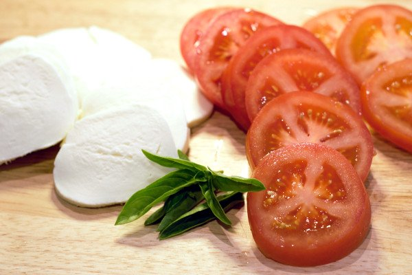 Thick Slices of Tomatoes, Fresh Mozzarella, and Basil.