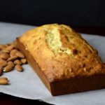 Golden Brown Banana Bread loaf with chopped almonds instead of walnuts.