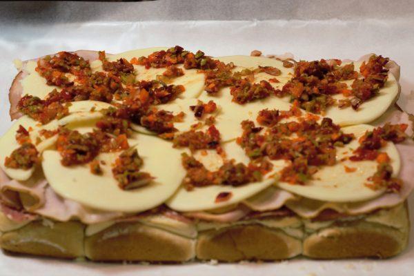 Cluster rolls layered with aoli, salami, ham, turkey, provalone, and muffaletta.