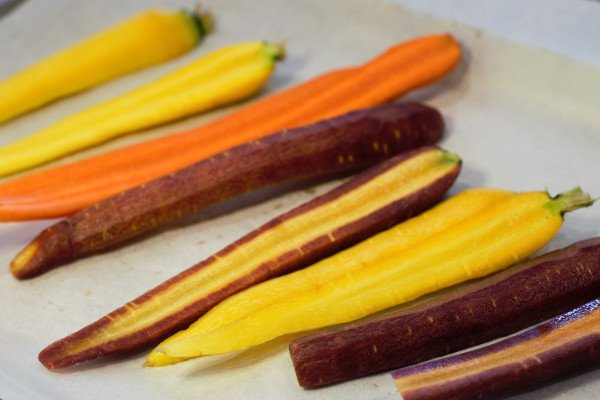 Carrots peeled, washed, and cut in half long ways.