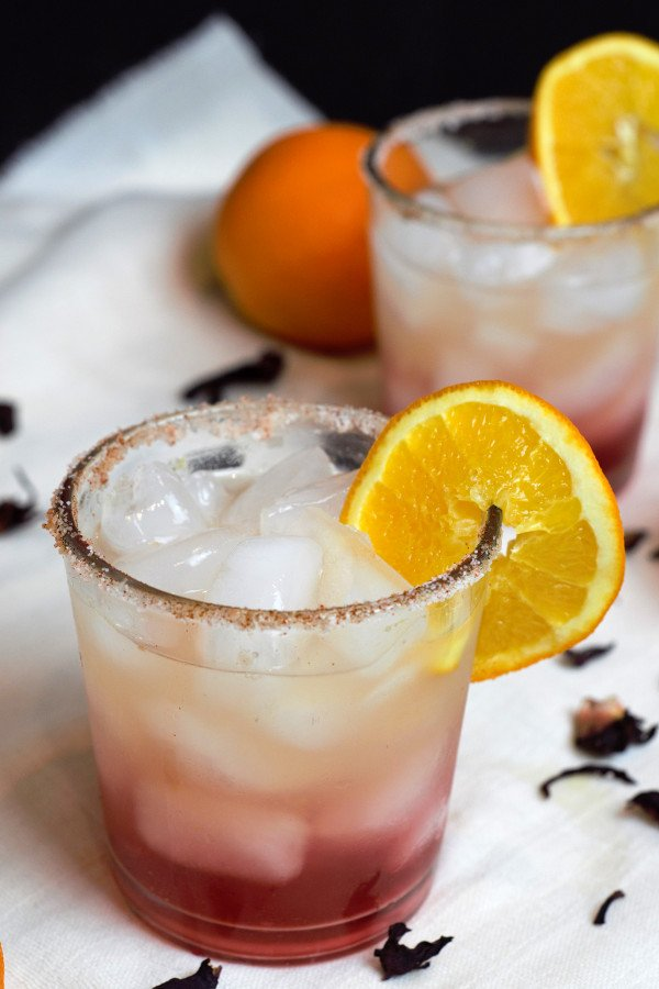 Beautifully layered Hibiscus Orange Margarita with a salt, sugar, and chili powder rim.