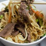 close up lo mein noodle with chop sticks