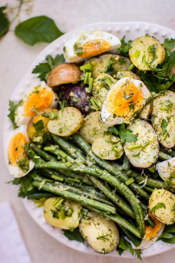 Roasted Potatoes, long greens beans, and hard boiled eggs with fresh herbs make a beautiful and unique dinner side