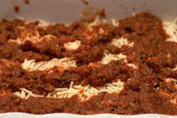 Shredded Mozzarella and Meat sauce. layers.