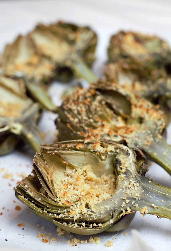 Perfectly steamed artichokes stuffed with parmesan, garlic bread crumbs finished under a low broiler for 4 minutes.
