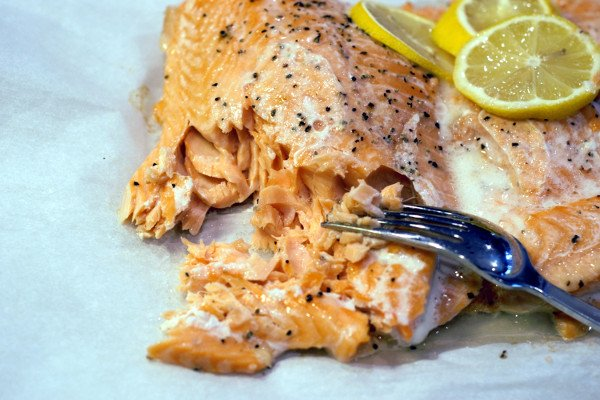Perfectly cooked salmon loin flakes apart with a fork and is a light pink color all the way through.