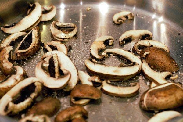 sliced mushrooms in a dry frying pan