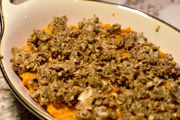 Crunchy butter pecan topping on perfectly mashed sweet potatoes are all ready for the oven.