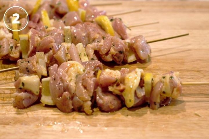 raw chicken on barbecue skewer