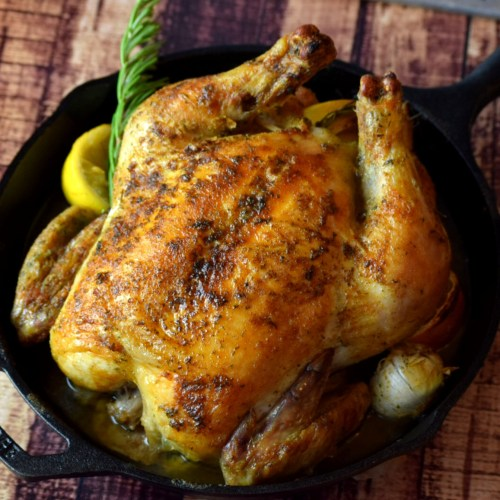 Roasted whole chicken in a cast iron pan