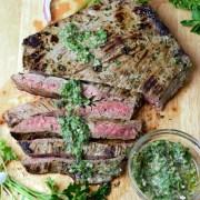 flank steak sliced with sauce and garnish