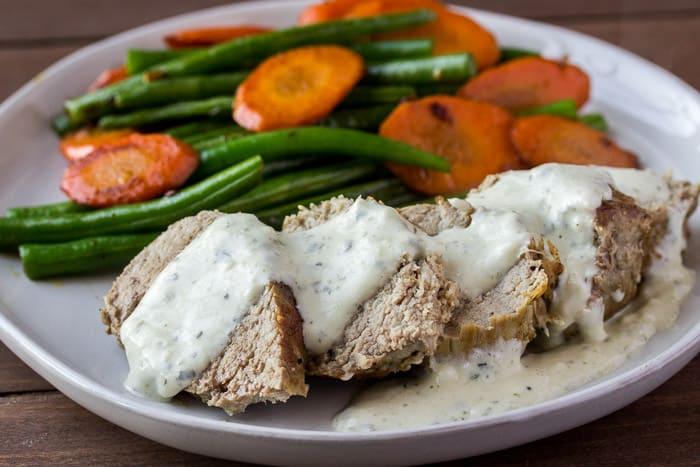 Home Chef Pork Tenderloin with Basil-Pecorino Sauce on a White Plate