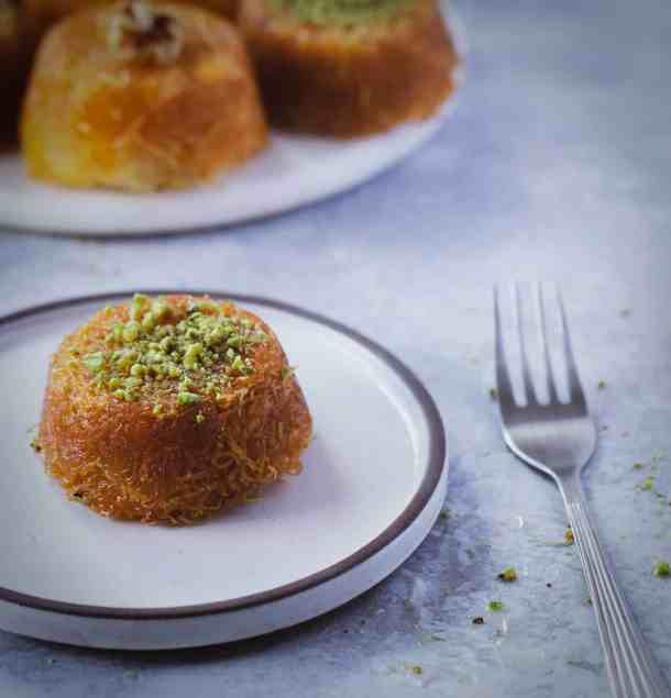knafeh cupcake on a plate with a fork