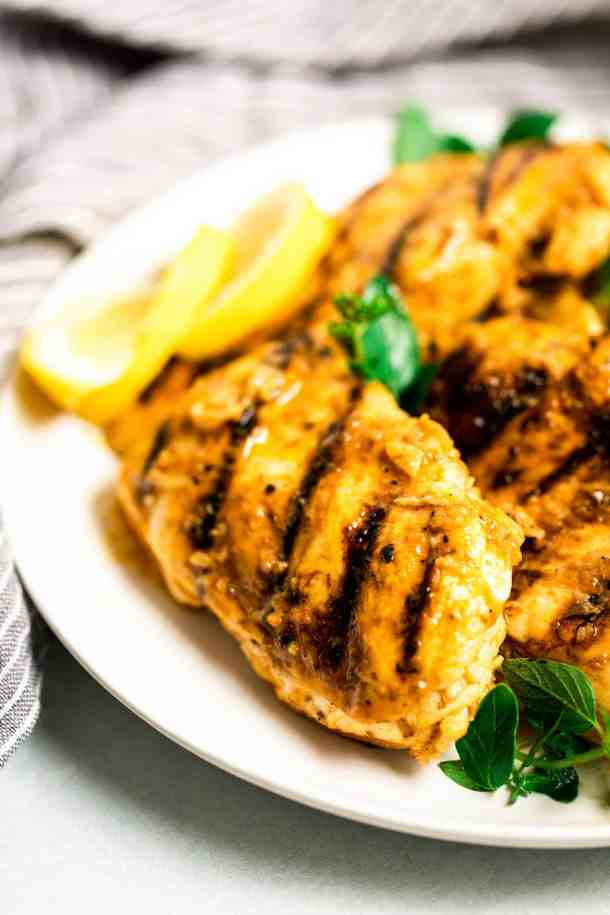 greek grilled chicken on a white plate