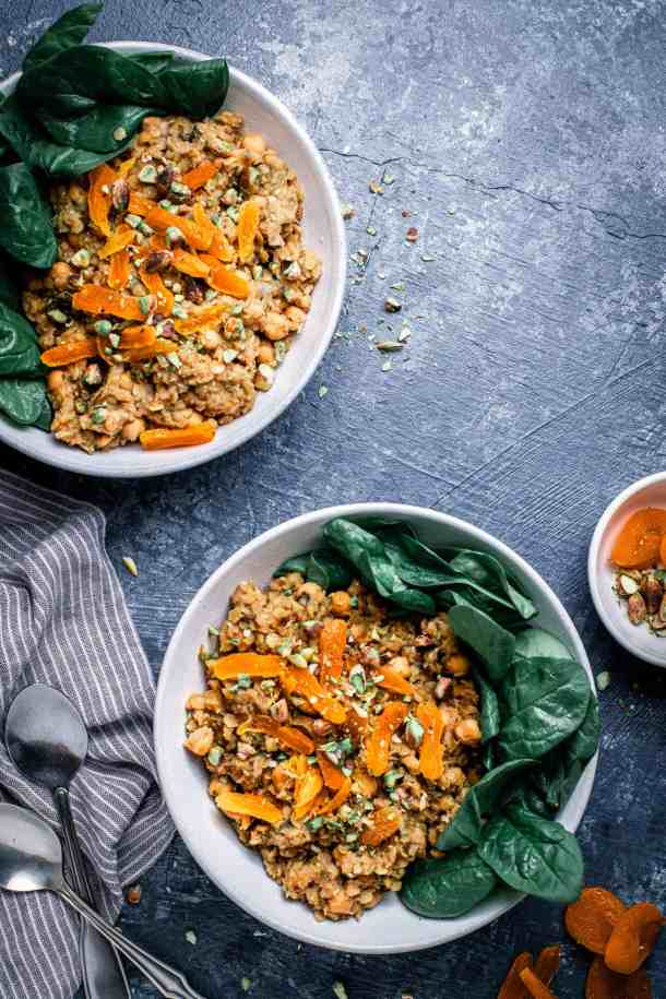 two bowls of warm red lentil salad