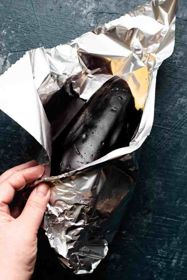 eggplant being wrapped in tin foil
