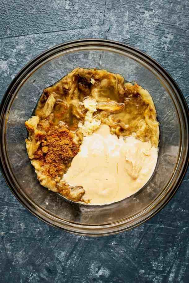 a bowl of baba ganoush ingredents