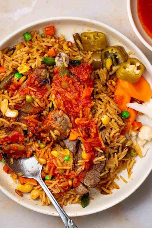 A white bowl full of lamb kabsa