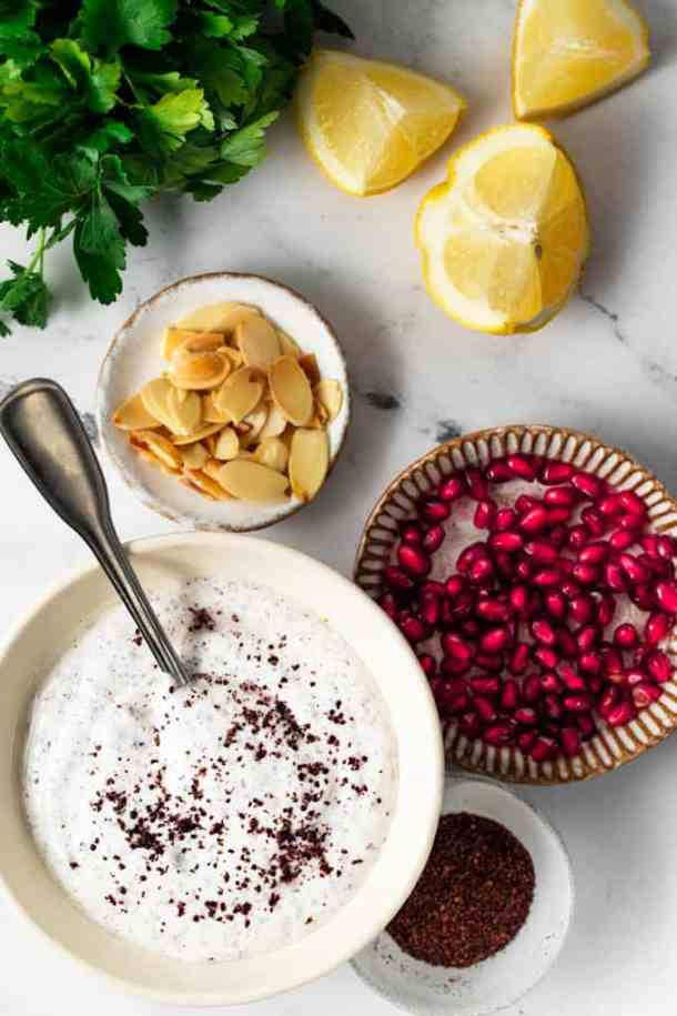 Ingredients lemons, pomergranates, almond slices , yogurt sauce and parseley