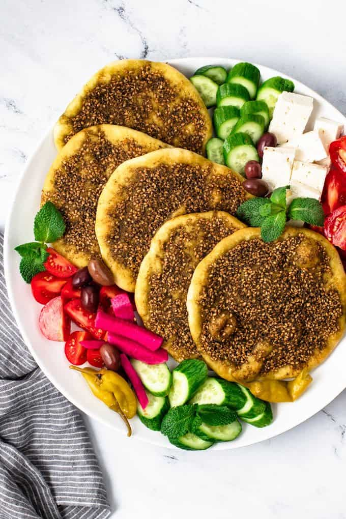 a large plate filled with za'atr manakish and vegetables