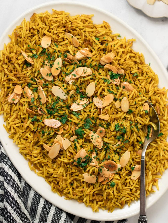 White platter plate filled with mediterranean yellow rice