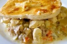 Classic Chicken Pot Pie served with 1 choice of veggie