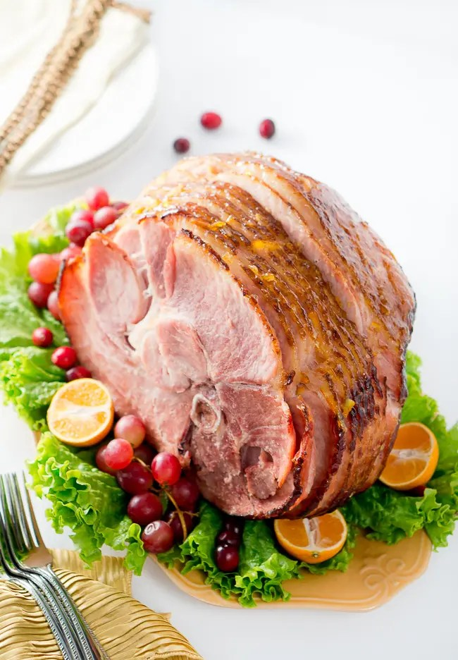 Orange Dijon Glazed Ham - Succulent spiral ham is brushed with a sweet and tangy orange dijon glaze, then roasted until perfection, creating a delicious caramelized outer layer.