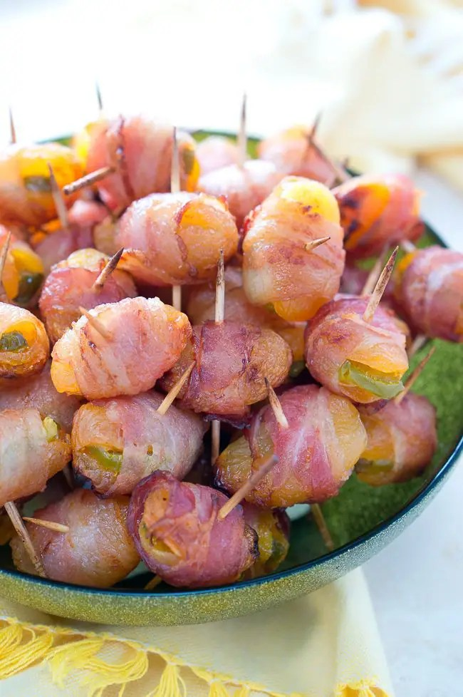 These sweet and spicy bacon wrapped apricots are a big hit every time! Perfect appetizer for any party and family gathering.
