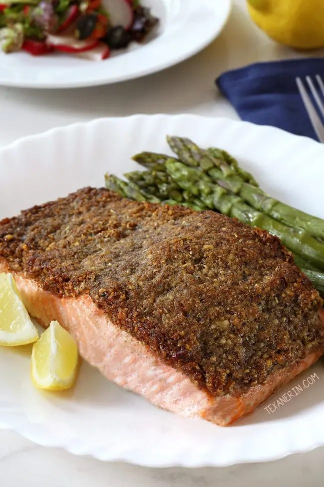 plate of pecan crusted salmon with steamed asparagus