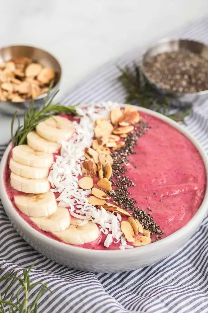 cranberry banana smoothie bowl with toppings