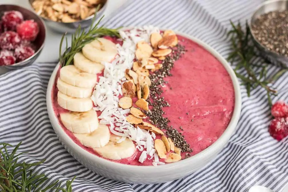 cranberry smoothie bowl with toppings