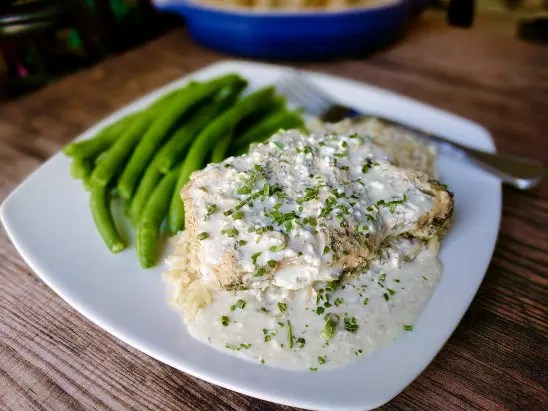 creamy ranch pork chops on plate with green beans