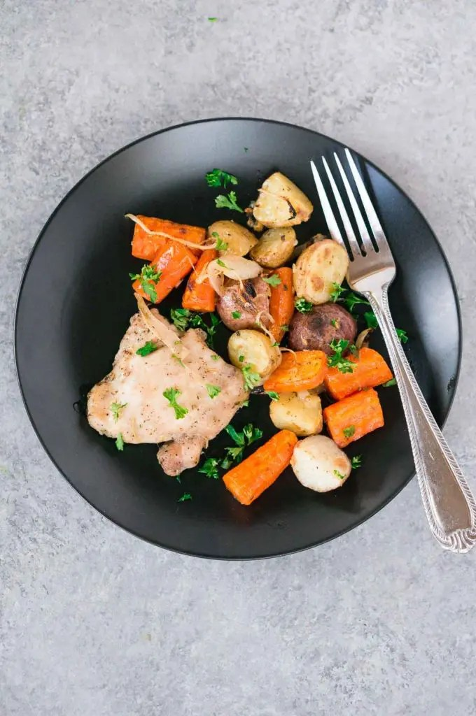 roasted chicken and potatoes and carrots