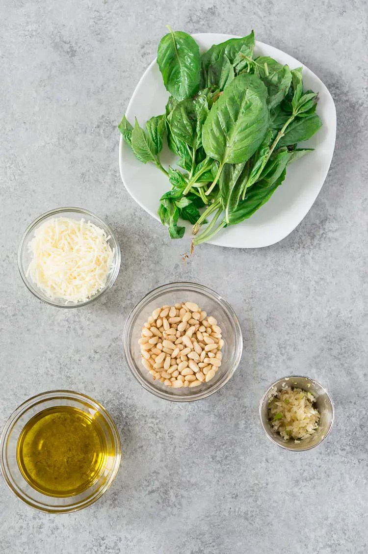 pesto ingredients on a gray board