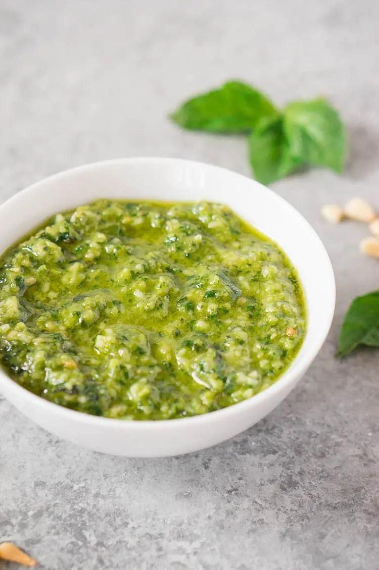 recipe for pesto sauce in a white bowl