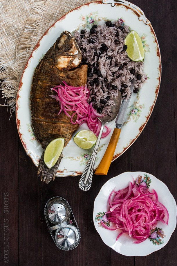 Fried Fish, Coconut Rice And Beans And Pickled Onions