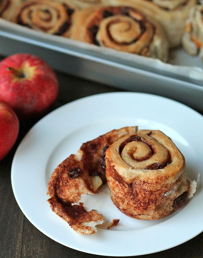 These vegan Apple Raisin Cinnamon Rolls are the perfect contribution to a brunch gathering or to a holiday breakfast table.