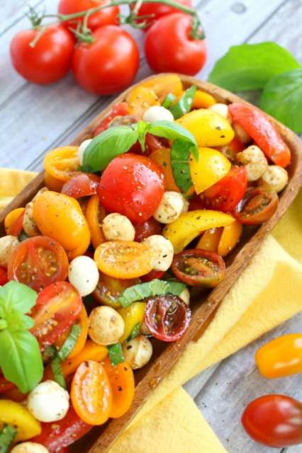 With just 6 ingredients, this simple tomato salad recipe will be your new go-to summer side! Â Made with fresh cherry tomatoes, mozzarella, basil and a 3 ingredient balsamic vinaigrette, this caprese salad takes just minutes to make and tastes incredible!