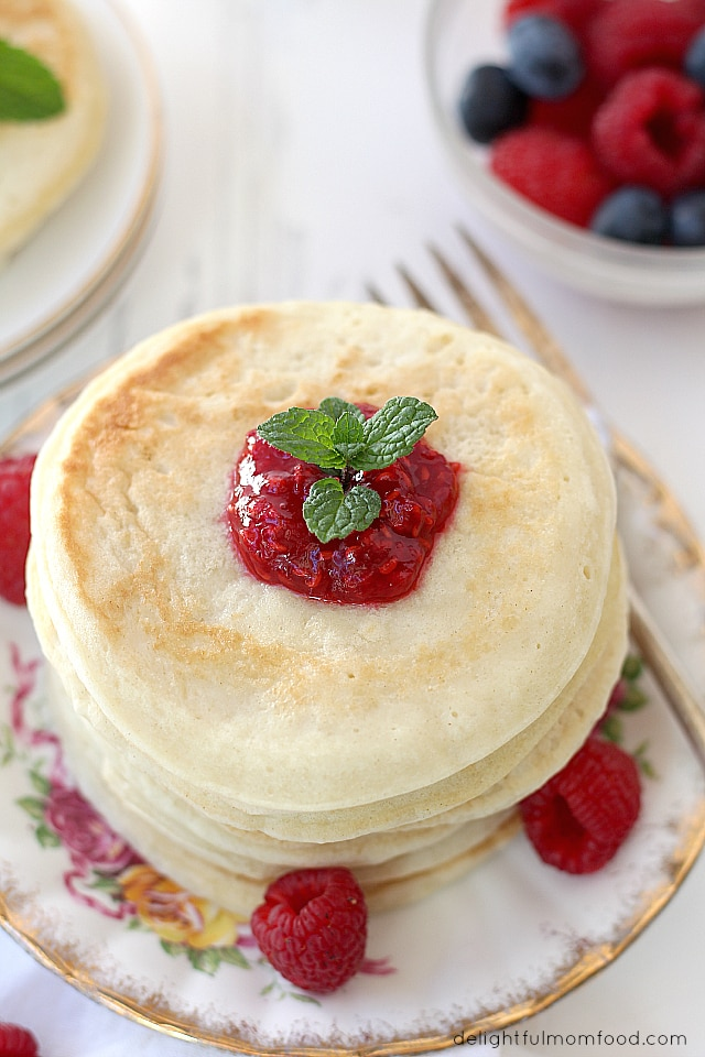 stacked pancakes with raspberry sauce