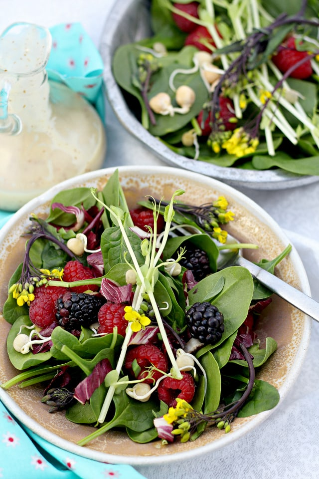 berries in baby spinach leaves with dressing