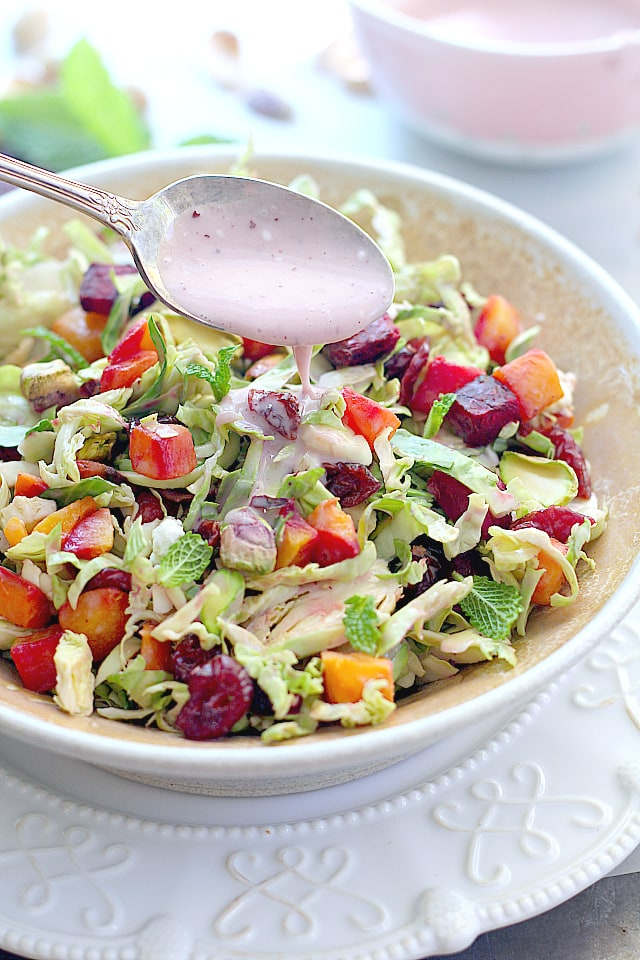 drizzling salad dressing on brussel sprout