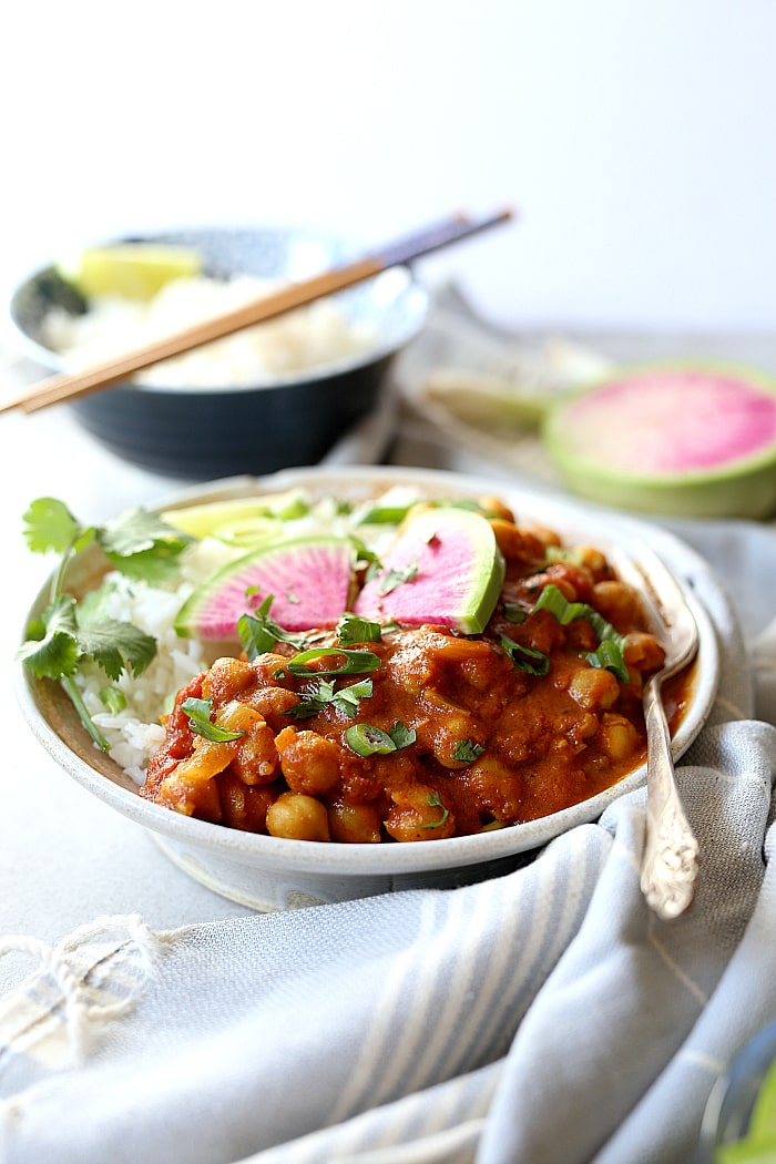 This 30-minute easy and healthy Indian Chana Masala recipe is made in 1-pot and simmered to delicious and nutritious perfection in coconut curry spices and a tomato base! Not only is it plump with chickpeas- it is vegan, gluten free and delicious tossed with rice or served with a side of roasted vegetables. #vegan #chana #masala #easy #healthy #glutenfree #chickpeas #recipe | Delightfulmomfood.com