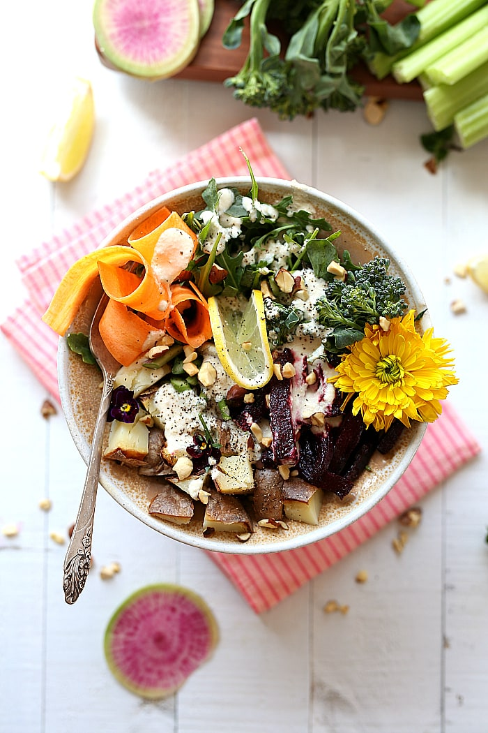 Everything but the kitchen sink in this spring root vegetable salad! It's a flavorful vegan and gluten-free kitchen sink salad made with leftover vegetables that would otherwise get thrown away! #spring #summer #salad #healthy #glutenfree #vegan #arugula #kitchensinksalad #recipe #maindish | delightfulmomfood.com