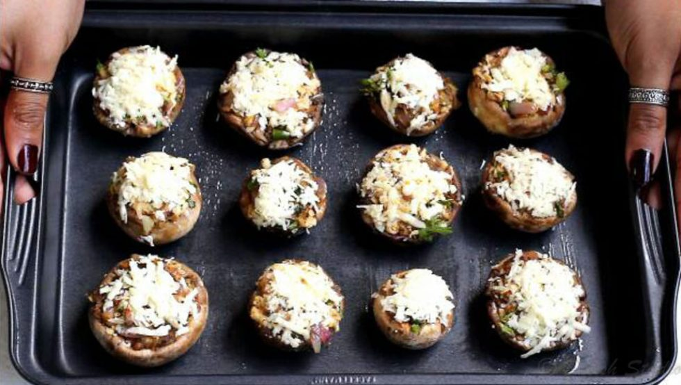 baked cheese stuffed mushrooms getting ready to be baked in oven