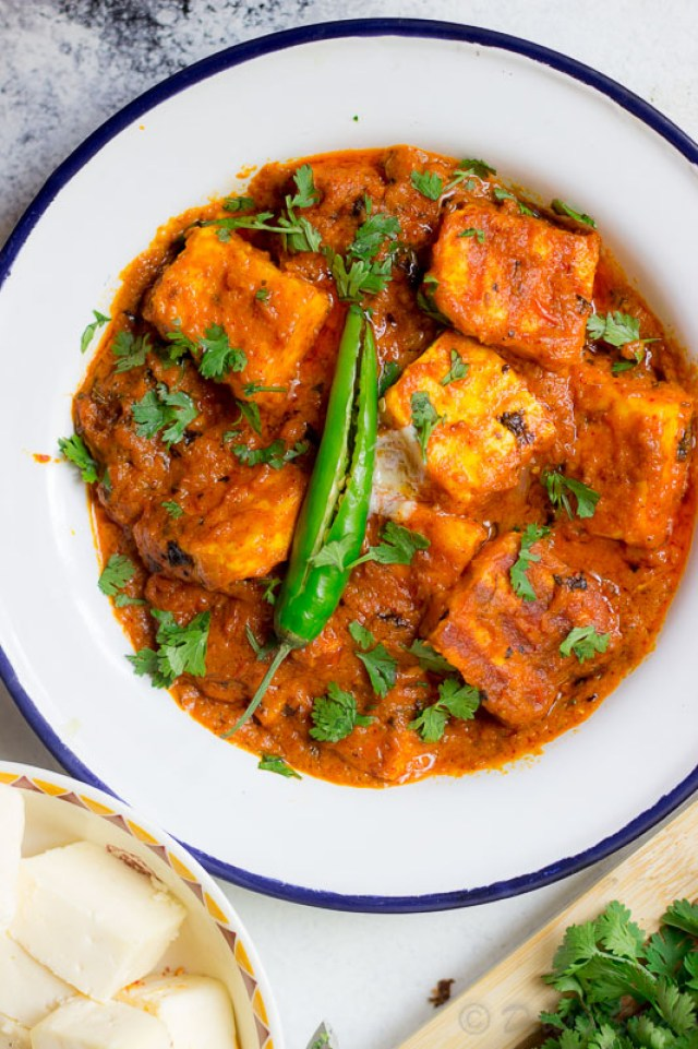Keto paneer makhani garnished with green chillies and coriander.