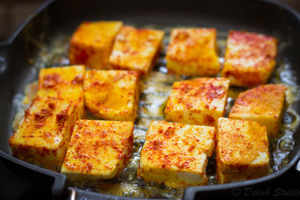 cottage cheese pieces being grilled in paneer for making keto paneer makhani (low carb) recipe.